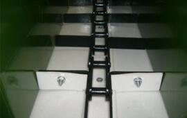 Покриття для шкребкового транспортера